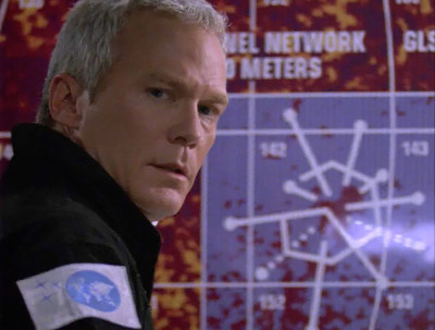 TC McQueen in font of a map of planet Daedalus
